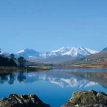 Beautiful Snowdonia reflected in a lake near Capel Curig Community Centre, North Wales.